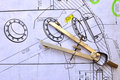 Compasses and the drawing over a mechanical sketch Stock Photo