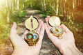 Compasses in the hands Royalty Free Stock Photo