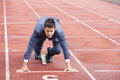 Competition a businessman on a track ready to run Royalty Free Stock Image