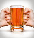 Competition of two hands with beer in glass Royalty Free Stock Photo