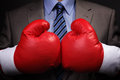 Competitive business tough concept businessman wearing boxing gloves Stock Image