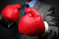 Competitive business tough concept businessman wearing boxing gloves Royalty Free Stock Photos