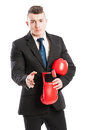 Competitive businessman giving hand for handshake Royalty Free Stock Photo