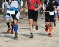 Competitive race with many athletes involved in race strenuous Stock Photography