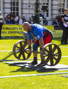 Competitors strain in the power lifting heat of the Ultimate Strongest Man competition. Royalty Free Stock Photo