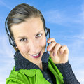 Complaint department young female employee with headset on background of blue sky Stock Photography