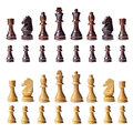 Complete chess set wooden with s full complement of pieces in both colours lined up in rows isolated on a white background Stock Image
