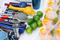 Complete cocktail set for bartender in blue. ime green and orange cocktails Royalty Free Stock Photo