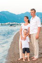 Complete family with son on the sea Royalty Free Stock Photo