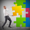 Complete a puzzle businessman inserting last piece Stock Images