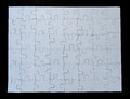 Completed White Jigsaw Puzzle on Black Background Royalty Free Stock Photo