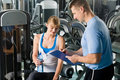 Completing personal fitness plan with trainer Stock Photography