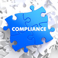 Compliance on blue puzzle white background Stock Images