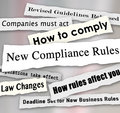Compliance headlines newspaper torn new business regulations rules words from the news including revised guidelines released law Stock Photo