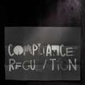 Compliance regulation design words on dark crumpled paper as concept Stock Image
