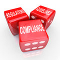 Compliance regulations guidelines three dice words the and on red to illustrate the need to follow rules and laws in conducting Stock Photos