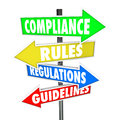 Compliance rules regulations guidelines arrow signs the words and on colorful road directing you to comply wih important laws or Stock Photo