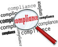 Compliance words magnifying glass rules regulations under to illustrate the importance of following and guidelines in your Royalty Free Stock Image
