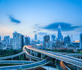 Complicated highway intersection at dusk with modern city skyline in shanghai road transportation infrastructure Royalty Free Stock Photo