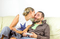 Complicity couple play video games sofa Royalty Free Stock Photo