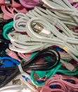stock image of  A bunch of colored wires for different phones