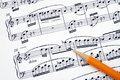 Compose the song on a music sheet Stock Image