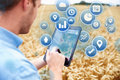Composite Of Farmer In Field Accessing Data On Digital Tablet Royalty Free Stock Photo