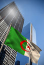 Composite image of algeria national flag against low angle view skyscrapers Royalty Free Stock Image