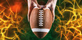 Composite image of american football player holding up football Royalty Free Stock Photo