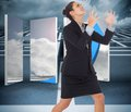 Composite image of angry businesswoman gesturing against big d maze under clouds Royalty Free Stock Photos