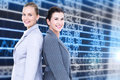 Composite image of attractive businesswomen standing back to back against stocks and shares Royalty Free Stock Photo