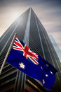 Composite image of australia national flag against low angle view skyscraper Royalty Free Stock Photos