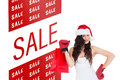 Composite image of beauty brunette in boxing gloves with shopping bag Royalty Free Stock Photo