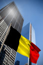 Composite image of belgium national flag against low angle view skyscrapers Stock Photography