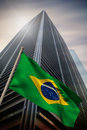 Composite image of brazil national flag against low angle view skyscraper Stock Photos