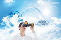 Composite image of business woman looking through binoculars against global graphic in blue Stock Photography