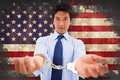 Composite image of businessman with handcuffs Royalty Free Stock Photo