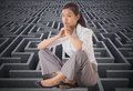Composite image of businesswoman sitting cross legged with hands together Stock Photography