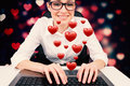 Composite image of businesswoman typing on a keyboard against valentines heart pattern Stock Image