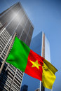 Composite image of cameroon national flag against low angle view skyscrapers Royalty Free Stock Photo