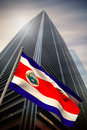 Composite image of costa rica national flag against low angle view skyscraper Royalty Free Stock Photo
