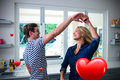 Composite image of couple dancing and valentines hearts 3d Royalty Free Stock Photo