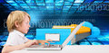 Composite image of cute boy using laptop Royalty Free Stock Photo