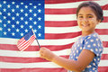 Composite image of cute girl with american flag Royalty Free Stock Photo