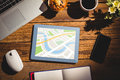Composite image of digital image of map against view a desk Stock Photography
