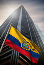 Composite image of ecuador national flag against low angle view skyscraper Royalty Free Stock Image
