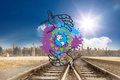 Composite image of environmentalism concept on paint splashes against train tracks leading to city under blue sky Stock Image