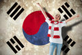 Composite image of excited asian football fan cheering against south korea flag Stock Images