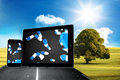Composite image of falling pills on tablet and smartphone screens against sunny green landscape with street Royalty Free Stock Images