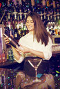 Composite image of female bartender mixing cocktail drink in cocktail shaker Royalty Free Stock Photo